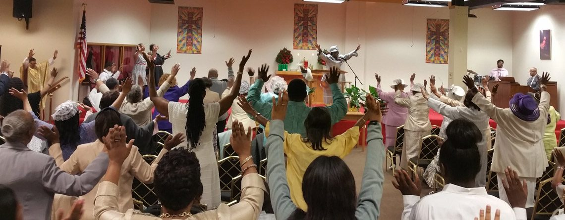 80 Parishioners with hands up